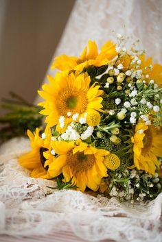 Hand Tied Wedding Bouquet Showcasing: Yellow Gerbera Daisies, Yellow Craspedia (Billy Balls, Billy Buttons), White Hypericum Berries, White Gypsophila (Baby's Breath)