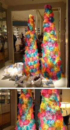 Christmas trees made out of cocktail umbrellas- darling!  I think a few of these umbrellas on a potted plant or fake palm tree (or other fake plant) would look great for a outdoor party too. Or even a bridal 'shower'.