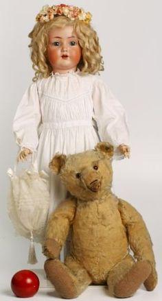 Prachtige antieke pop en beer
