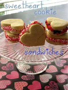 Sweetheart Cookie Sandwiches  For Sugar Cookies:    1 c butter, softened  1/2 c sugar  1 tsp vanilla  2 large egg yolks  2 1/2 c all-purpose flour  For Cinnamon-Vanilla Frosting:    1 container vanilla frosting  1 tsp cinnamon extract  1 small dab Wilton pink food coloring gel (or a couple drops neon pink food coloring)  Assorted sprinkles, non-pareils, etc