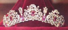 The Savoy Pink Topaz Tiara originally belonged to Queen Maria Theresa of Sardinia, a member of the Habsburg family who died in 1855. Her son Ferdinand, the Duke of Genoa, inherited the tiara. His wife, Princess Elisabeth of Saxony, wore it and eventually bequeahed it to her daughter Margherita of Savoy. Margherita married King Umberto I of Italy. It has remained with their descendants to this day. Prince Vittorio Emanuele now owns the piece, and his wife, Princess Marina, dons it…