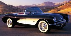 My absolute dream car, a 1957 Corvette. Black body with white fender cove detailing. interior...either solid black or black trimmed with red, i havent decided yet.