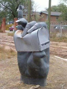 Art that is a bit weird, a bit unusual, and a bit twisted. Makes you wonder if that's what will happen to the mailman if he puts bills in the box. - - - - - Unusual mailbox<<Is satan holding my mailbox for me? Funny Mailboxes, Unique Mailboxes, Custom Mailboxes, 3d Street Art, Statues, Sculpture Art, Sculptures, Creepy Hand, Art Postal