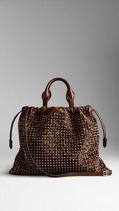 Gorgeous bag. Must be Burberry Prorsum