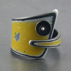 This fun and funky ring was made using metal salvaged from a 42 GMC pickup. The original car paint is left intact and unaltered.This ring is designed to be comfortable and easy to wear.Size 6