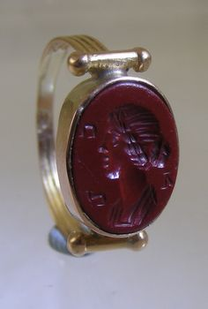 Probably Ptolemaic red jasper intaglio from Alexandria, ca. second century A.D. in an early nineteenth century gold setting in the manner and style of an early Roman ring.