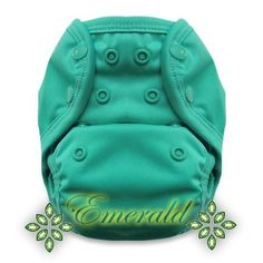 Emerald - - Tuck-Wrap-Go Cover - Size 1 - Retired Prints – Nuggles Designs Canada - This is a waterproof cover. Use it with an absorbent insert, or over a fitted diaper. You can also use it over a disposable diaper to prevent blowouts (think long car-rides, bouncy chairs etc.) Just rinse, wash, dry, reuse!
