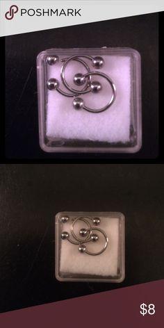 BNIB 3 lip rings/earrings Lip ring/earrings, 3 rings with ball screws. BNIB. Surgical Steele. Jewelry