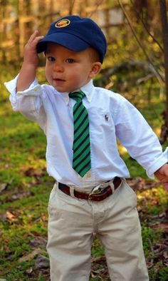 Precious little boy wearing a Ralph Lauren button down, navy & green strip tie, and southern proper hat