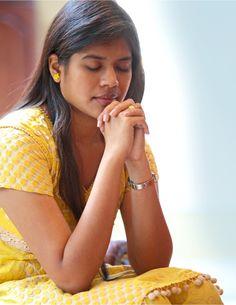 A woman praying to God