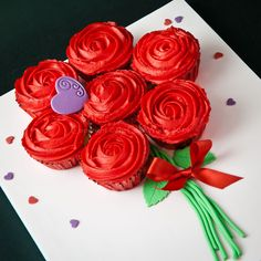 Delicious red butter iced roses as a bouquet of cupcakes