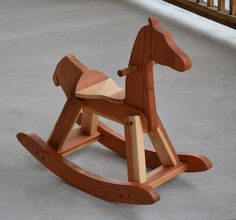 """Our Redwood Rocking Giraffe is of heirloom quality and is designed for children to ride and enjoy for many years and for generations to come to enjoy. They are designed for ages 1 and up. Riding helps to develop gross motor skills as well as the imagination of the child. The giraffes are made one at a time in our shop. Our giraffes are hand rubbed down with Danish oil.    Dimensions: 29"""" long, 28"""" high, 14"""" seat height, 13"""" wide"""