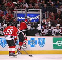 Colorado Avalanche at Chicago Blackhawks Game W 3-2- 03/06/2013 Brent Seabrook #7 dumps Patrick Bordeleau #58 into the Colorado Avalanche bench with Andrew Shaw #65 overlooking.  (Photo by Jonathan Daniel/Getty Images)