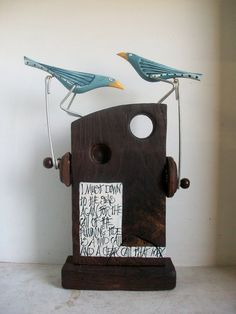 A splendid mechanical toy made from reclaimed wood, sees birds pecking as you turn the handle. @opishop #sustainabledesign