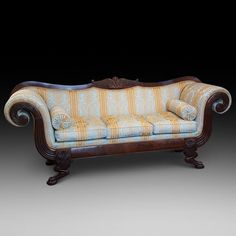 Regency Mahogany Framed Sofa with Bulbous Scroll Arms Carved with Acanthus Leaves, Cabriole Legs with Claw Feet, Carved Rosettes to the Frame and Shel