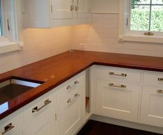 """1 ¼"""" thick teak premium wide plank countertop. Golden Brown #2 color with Marine Oil Finish and an eased-square edge."""