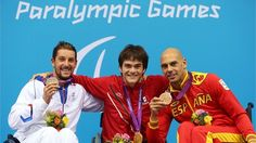 (L-R) Silver medallist David Smetanine of France, gold medallist Gustavo Sanchez Martinez of Mexico and bronze medallist Richard Oribe of Spain pose on the podium during the medal ceremony for the men's 200m Freestyle - S4 final on Day 10 of the London 2012 Paralympic Games at the Aquatics Centre.