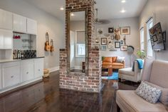 The brick fireplace that is the centerpiece of Tiffany's combined office and living room was hiding in a closet and uncovered by contractors during the renovation. Tiffany's Charming New Orleans Sanctuary