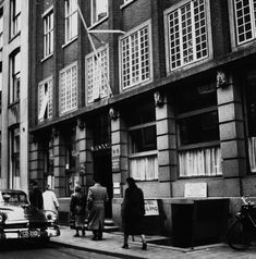1945-1950. View on the Gewestelijk Arbeidsbureau (GWA) at the Nieuwe Doelenstraat in Amsterdam. The resistance movement in Amsterdam committed on January 1945 an attack on the Gewestelijk Arbeidsbureau to sabotage the registration of men forced to work in the German war industries. Six workers at the Gewestelijk Arbeidsbureau were killed and 3 wounded. As reprisal five prisoners were executed on January 8 and on January 18 eleven GAB-workers on the Amsteldijk at Rozenoord. #amsterdam…