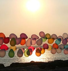 I can't stop thinking about the balloons I saw at this kid's birthday party on the beach yesterday.  Wish I had taken a photo.  They were amazing and there were so many of them.