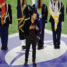 Country music artist Luke Bryan sings the national anthem before #SuperBowl 51 between the Atlanta Falcons and the New England Patriots. (AP Photo/Charlie Riedel)