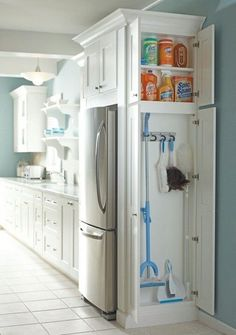 Add a slender cabinet to any dead space in your kitchen. It's a brilliant spot to stash skinny cleaning supplies like brooms and dustpans. #homedecor