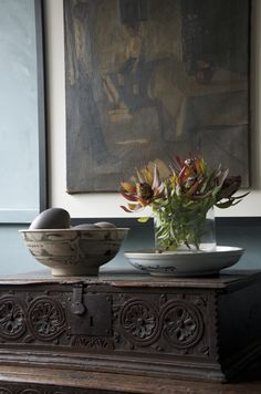 Interior by Josephine Marshall @ one Rundle Trading Co.  Gorgeous array of ornaments, including native Australian flowers, Emu eggs, paired with antique furniture and exotic framed textile.