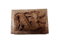 This is an exculsive secret box in superior quality walnut wood with dragon on top.  Slide the secret panel at the bottom to unlock the box then open it. Visit www.tnzcreations.com