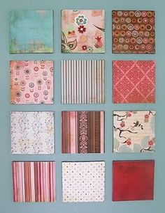 $1 canvas prints, edges spray painted and scrapbook paper cut and glued to size then sprayed with enamel coat.  Easy and inexpensive idea for custom wall art.  I may have to do this one!