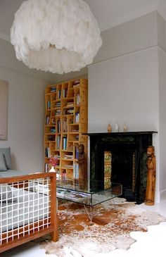 Ostrich feather light and shelving unit made of wood boxes---great contrasts in hard v. soft