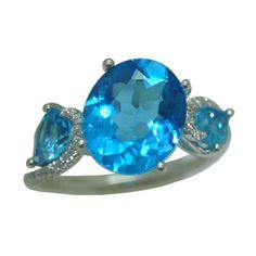 Blue Topaz Ring with 0.12 Cttw. Diamonds https://www.goldinart.com/shop/rings/colored-gemstone-rings/blue-topaz-ring-with-0-12-cttw-diamonds #14KaratWhiteGold, #BlueTopazRing
