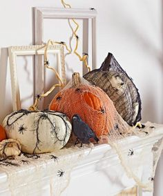 Create a creepy mantel with plastic spiders, ripped cheesecloth and a faux crow. More easy pumpkin decorating ideas: http://www.midwestliving.com/homes/seasonal-decorating/pumpkin-decorating-projects/?page=3,0