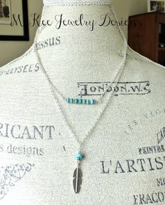 Turquoise howlite stone with silver chain and silver feather bead.