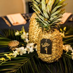 Sweetly Paired Wedding Planning - Website: sweetlypaired.com - Contact us: love@sweetlypaired.com - Instagram: @sweetlypaired –Photography: leedphoto.com – Floral: Bella Calla - table decor, gold pineapple centerpieces, palm fronds, gold navy and green wedding colors, cielo at castle pines reception, colorado wedding inspiration, mountain wedding planner