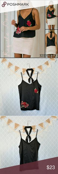 Karla Silky Cami in Black Details: Silky sleeveless white loose-fit cami with front floral appliques and matching choker neckerchief  Brand: Boutique Brand  Size: Large Measurements: Bust/ 38-39 inches   Length/23-29 inches  Size: X-Large Measurements: Bust/ 40-42 inches   Length/24-30 inches  Condition: New and packaged Tops