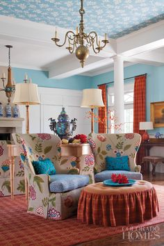 LEO Interiors:  swooning over the turquoise and tangerine!  Antique brass light fixture, papered ceiling, georgeous fabrics!