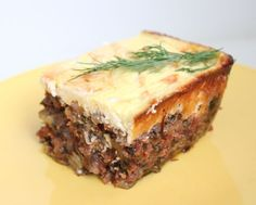 Inspired by Greek Moussaka, the flavors in this casserole of layered eggplant and ground meat might sound a little unusual, but it's a mild dish that's likely to appeal to everyone at the table. From Mark's Daily Apple Primal Recipes, Greek Recipes, Real Food Recipes, Cooking Recipes, Healthy Recipes, Paleo Meals, Flour Recipes, Paleo Food, Vegetarian Food