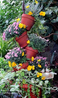 Make Your Own Tipsy-pots Planter!  (Garden of Len  Barb Rosen)  http://ourfairfieldhomeandgarden.com/diy-project-build-your-own-tipsy-pots-planter/