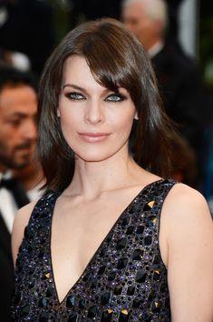 Milla Jovovich Medium Straight Cut with Bangs - Milla Jovovich Hair Looks - StyleBistro