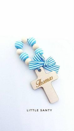 This personalised Mini Rosary (Decade) makes a lovely gift for your Christening/Baptism, Holy Communion, Wedding, etc, for your guests, family and friends.  Lovely wooden cross with name on the front and date on the back.   Please feel free to choose:  striped beads - pink or blue