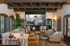 Robert Pattinson's Spanish Colonial Home in Los Feliz, CA - Screening Room (how awesome that Bringing Up Baby is on the screen!)