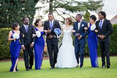 Example of groom in blue and groomsmen in black with royal blue ties (and bridesmaids in royal blue)