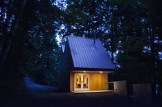 Small Studio House Design with Double Pitched Roof by Jeffery S.Poss Architect.