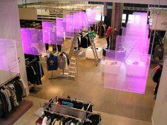 Edge Lighted LED Signage: Rotating coloured LED edge lit acrylic hanging panels