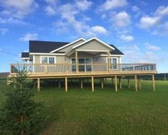 Looking for a Prince Edward Island vacation rental? Browse the best selection of PEI vacation cottages to rent. Book your vacation today! Beach Houses For Rent, Covered Pergola, Prince Edward Island, Outdoor Living, Outdoor Decor, Cabin Rentals, Ideal Home, Patio, House Styles
