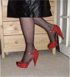 Red heels and a below knee leather skirt
