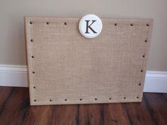 Burlap on corkboard.