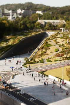 The new campus complex for the EWHA Woman's University in Seoul is part building, part green space and part sculpture. This constructed landscape is molded like a canyon and topped with gardens that fill the Shinchon area with an unexpected yet welcome park. Designed by Dominique Perrault Architecture, the campus is formed by two linear buildings that sandwich a long multi-purpose plaza, which can be used for lectures, events, recreation space and leisure.