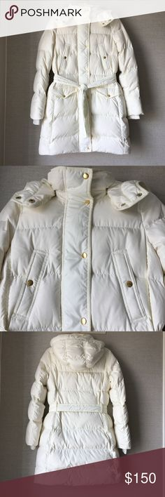 """J. Crew Wintress belted puffer coat Bright Ivory EUC - Winter, meet your new nemesis: J.Crew's  long down puffer coat is a cold-weather rebel, designed to insulate (even when you can't remember what the sun feels like). A roomy hood retains extra degrees while a waist-nipping belt makes the silhouette flattering. Down-filled poly. Hidden zip with snap closure. Pockets. Lined. Machine wash. Import. Item B5123.  Fitted. Approx. Body length: 35 5/8"""". Hits most above knee. J. Crew Jackets…"""