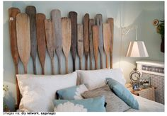 Blog post on lots of ideas using driftwood and other ocean memorabilia......old oar headboard makes a statement - fun for decorating coastal home or beach house.